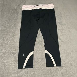 Lululemon Inspire Crop II. Black with very light pink. Size 10. Excellent cond.